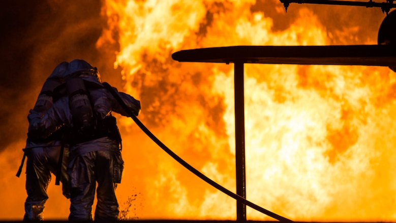 Marines extinguish a fire during a controlled burn training exercise aboard Marine Corps Air Station Beaufort Feb. 17. The Marines with Aircraft Rescue and Firefighting are trained to be ready to respond for an emergency within three minutes. The Marines are with ARFF.