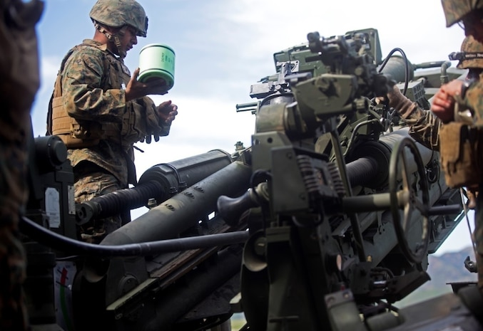 Lance Cpl. Faustino J. Camilo prepares to load a M231 primer into the M777 Howitzer cannon during a battery-level fire exercise at Camp Pendleton, Calif.,  Feb. 10, 2016. The battery participated in a fire exercise in preparation for their upcoming deployment with the 31st Marine Expeditionary Unit. This exercise was the first time the battery used the Digital Firing Control System, a computer that shows grid coordinates of targets and accompanying information. This system is important because it provides a faster response time than using iron sights to fire the howitzer. Camilo, from Brunswick, Ga., is an artillery cannoneer with Battery F, 2nd Battalion, 11th Marine Regiment, 1st Marine Division. (U.S. Marine Corps Photo by Lance Cpl. Justin E. Bowles)