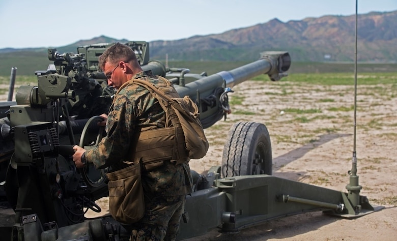 Sgt. Kenneth A. Ashcraft references coordinates from the Digital Firing Control System and calibrates the direction of the M777 Howitzer cannon during a battery-level fire exercise at Camp Pendleton, Calif., Feb. 10, 2016. Marines performed fire exercises in preparation for their upcoming deployment with the 31st Marine Expeditionary Unit. This exercise was the first time the battery used the DFCS, a computer that shows grid coordinates of targets and accompanying information. This system is important because it provides a faster response time than using iron sights to fire the howitzer. Ashcraft, from Tyler, Texas, is a field artillery cannoneer with Battery F, 2nd Battalion, 11th Marine Regiment, 1st Marine Division. (U.S. Marine Corps Photo by Lance Cpl. Justin E. Bowles)