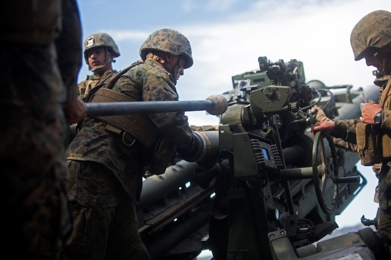 Marines work together to load a 155mm round into the M777 Howitzer cannon during a battery-level fire exercise at Camp Pendleton, Calif., Feb. 10, 2016. The battery participated in a fire exercise in preparation for their upcoming deployment with the 31st Marine Expeditionary Unit. This exercise was the first time the battery used the Digital Firing Control System, a computer that shows grid coordinates of targets and accompanying information. This system is important because it provides a faster response time than using iron sights to fire the howitzer. The Marines are with Battery F, 2nd Battalion, 11th Marine Regiment, 1st Marine Division. (U.S. Marine Corps Photo by Lance Cpl. Justin E. Bowles)