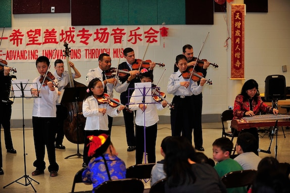 Students of the Hope Chinese Immersion School perform alongside members of the Air Force Strings. The performance, celebrating Chinese New Year, was part of The U.S. Air Force Band's educational outreach program. (Photo courtesy Hope Chinese Immersion School/released)