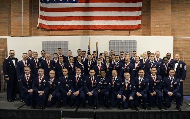 Col. Stephen Kravitsky, 90th Missile Wing commander, and Chief Master Sgt. Samuel Couch, 90th Missile Wing command chief, pose for a photograph with the graduating ALS class 16-C members in the Fall Hall Community Center Feb. 17, 2016. (U.S. Air Force photo by Senior Airman Jason Wiese)