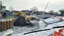 Excavating the last of the material from the southside of the former Sears Parking Lot to form the new flood risk management channel – January 14, 2016. Muddy River Flood Risk Management and Environmental Restoration.