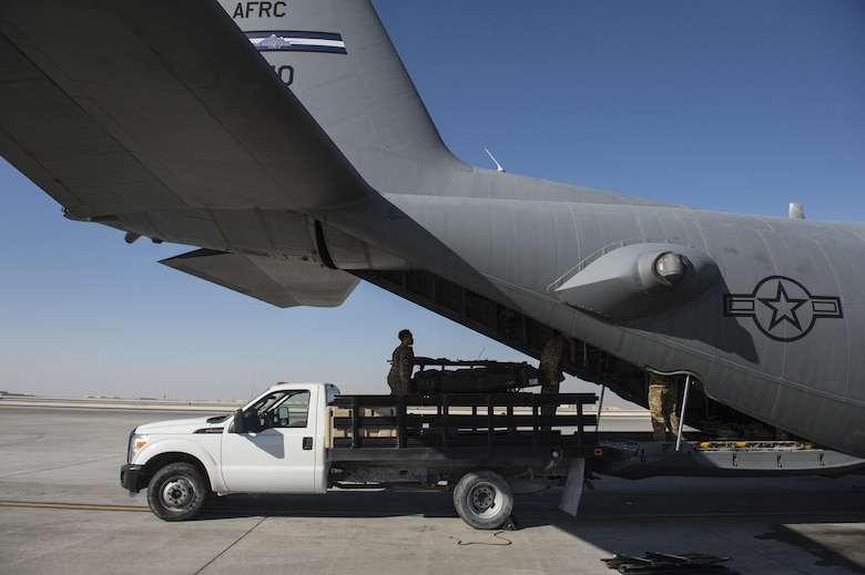 Members of the 379th Expeditionary Aeromedical Evacuation Squadron load a U.S. Air Force C-130 Hercules with medical equipment at Al Udeid Air Base, Qatar, Feb. 11, 2016. A typical 379th EAES mission includes transporting patients to locations with more definitive medical care or returning recovered personnel to duty at their deployed locations. (U.S. Air Force photo by Staff Sgt. Corey Hook/Released)