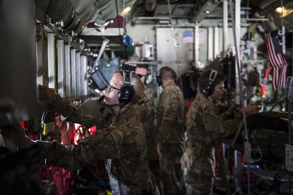 Members of the 379th Expeditionary Aeromedical Evacuation Squadron adjust the configuration inside a U.S. Air Force C-130 Hercules during an aerovac mission from Al Udeid Air Base, Qatar, Feb. 11, 2016. A typical 379th EAES mission includes transporting patients to locations with more definitive medical care or returning recovered personnel to duty at their deployed locations. (U.S. Air Force photo by Staff Sgt. Corey Hook/Released)