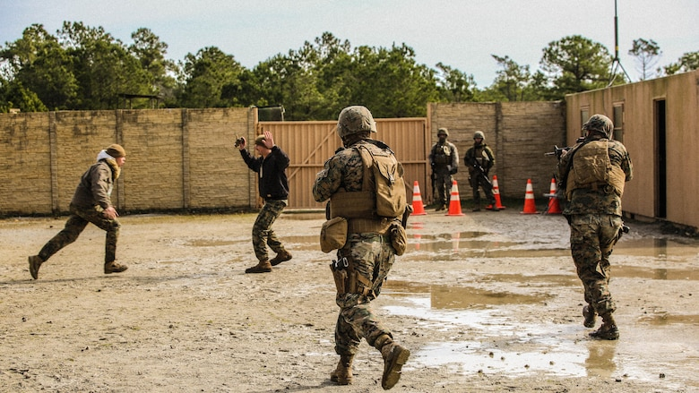 Marines with Bravo Company, 2nd Law Enforcement Battalion, simulate civilians in physical altercations at a forward observation base, which requires Marines to step in and take control of the situation during an interior guard training exercise at Forward Observation Base Hawk at  Marine Corps Base Camp Lejeune, N.C., Feb. 17, 2016. The training prepared Marines to conduct real-life site security operations.