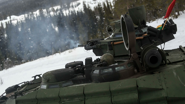 The Mk 19 of an amphibious assault vehicle fires across the valley of a range in Rena, Norway during a live-fire exercise Feb. 17, 2016. The Marines and the Norwegian Army are preparing themselves for Exercise Cold Response 16, which will bring together 12 NATO allies and partner nations and approximately 16,000 troops in order to enhance joint crisis response capabilities in cold weather environments.