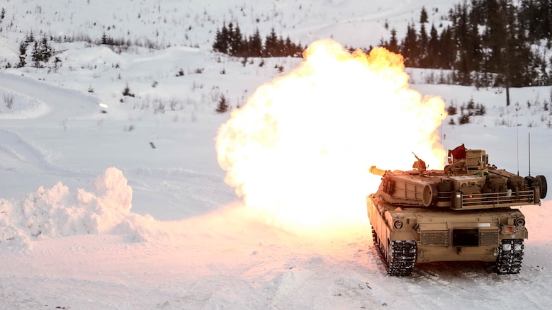 A M1A1 Abrams tank fires its main gun as it takes part in a live-fire exercise in Rena, Norway, Feb. 18, 2016. The Marines are preparing themselves for Exercise Cold Response 16, which will bring together 12 NATO allies and partner nations and approximately 16,000 troops in order to enhance joint crisis response capabilities in cold weather environments.
