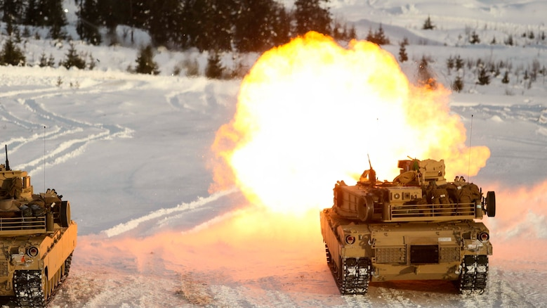 A U.S. Marine Corps M1A1 Abrams Tank creates some warmth as it takes part in a live-fire exercise in Rena, Norway, Feb. 18, 2016. Tanks with Combined Arms Company took to the firing line as part of a training exercise integrating both U.S. and Norwegian forces. The Marines and Norwegians are preparing themselves for Exercise Cold Response 16, which will bring together 12 NATO allies and partner nations and approximately 16,000 troops in order to enhance joint crisis response capabilities in cold weather environments.