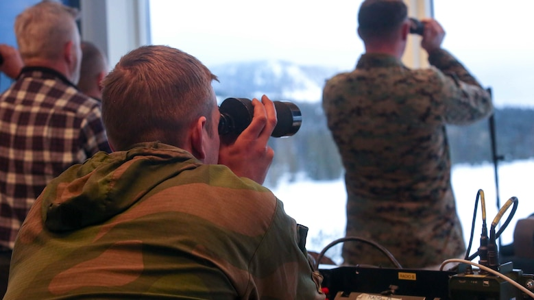 A member of the Norwegian Army looks at the down range area as U.S. Marines conduct a live-fire exercise in Rena, Norway, Feb. 17, 2016. The Marines are preparing themselves for Exercise Cold Response 16, which will bring together 12 NATO allies and partner nations and approximately 16,000 troops in order to enhance joint crisis response capabilities in cold weather environments.
