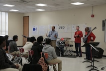 """On Feb. 17, 2016, a jazz combo from """"The President's Own"""" U.S. Marine Band presented a Music in the High Schools program at Fairmont Heights High School in Capitol Heights, Md. The performance included music from the combo's """"musical heroes."""" At the conclusion of the program one of the students raised his hand and said, """"I've only been playing the bass for three months. I didn't know you could make it sing like that."""" He pointed to the combo's bass player and said, """"He is my musical hero!"""" (U.S. Marine Corps photo by Master Sgt. Kristin duBois/released)"""