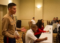 Captain Matthew Ervine discusses the importance of leadership in the workplace during the Mexican American Engineers and Scientists Leadership Academy leadership workshop in San Antonio, February 18, 2016. Ervine currently serves as a Diversity Officer at Marine Corps Recruiting Command in Quantico, VA. The presence of the Marine Corps at MAES creates a positive reminder to those participating that the Marine Corps continues to seek out diversity in its ranks and leaders.