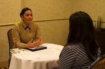 Captain Evita Mosqueda-Chapman speaks to a student about different career opportunities available in the Marine Corps during the Mexican American Engineers and Scientists career fair in San Antonio, February 18, 2016. Partnering with Latino organizations like MAES provides the Marine Corps with the ability  to build relationships with influential community leaders who become brand ambassadors for the Marine Corps. Mosqueda-Chapman currently serves as the assistant logistics officer with 4th tank battalion, 4th Marine Division.