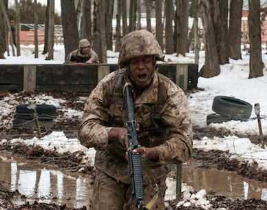 """Candidates assigned to Delta Company, Officer Candidates Class-221, work together to complete the Buddy Team Fire and Movement Course at Brown Field, Marine Corps Base Quantico, on Jan. 28. The mission of Officer Candidates School (OCS) is to """"educate and train officer candidates in Marine Corps knowledge and skills within a controlled, challenging, and chaotic environment in order to evaluate and screen individuals for the leadership, moral, mental, and physical qualities required for commissioning as a Marine Corps officer."""""""