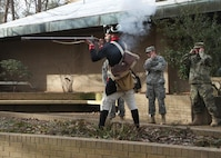 Dressed in a period correct Continental uniform, Guilford Courthouse National Park ranger Jason Baum fires a rifle similar to those Continental soldiers would have employed against the British Army during the Revolutionary War. The demonstration was part of a staff ride conducted by the 108th Training Command (IET) at the Greensboro, N.C., park on Feb. 6. The staff rides are training events used by staff members of the unit to learn important lessons from the past in order to ensure success in future conflicts. (U.S. Army photo by Sgt. Javier Amador)