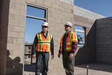 Rich Fontanilla (left), the Area Engineer for the U.S. Army Corps of Engineers Los Angeles District's Arizona-Nevada Area Office, and Pete Pupparo, resident engineer for the District's Las Vegas Resident Office, visit a 240-room dormitory project at Nellis Air Force Base Feb. 11. The $30.4 million H-shaped complex features 60 quads; each with a four-bedroom and four-bathroom unit, a shared kitchen, laundry and dining area.