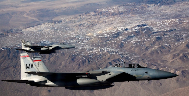 F-15C Eagles assigned to the 131st Fighter Squadron at Barnes Air National Guard Base, Mass., and the 194th Fighter Squadron at Fresno Air National Guard Base, Calif., wait to refuel beside a KC-135 Stratotanker during a Red Flag 16-1 training mission on Feb. 11, 2016. The concept of Red Flag was developed by Maj. Moody Suter to simulate the first 10 combat missions pilots would face. (U.S. Air Force photo/Master Sgt. Burt Traynor)