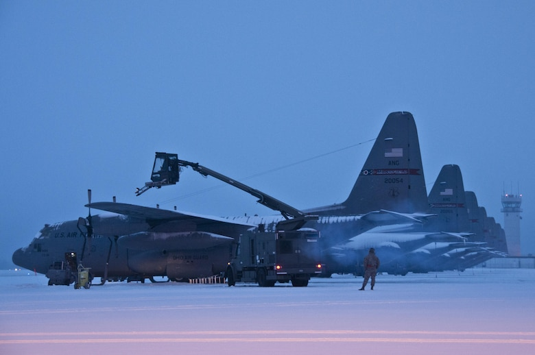 Ohio Air National Guard members work in the early morning of Feb. 16, 2016, to remove snow from the flightline and fleet of C-130H Hercules at the 179th Airlift Wing, Mansfield, Ohio. The Ohio ANG unit is always on mission to respond with highly qualified citizen Airmen to execute federal, state and community missions. (U.S. Air National Guard photo/Tech. Sgt. Joe Harwood)