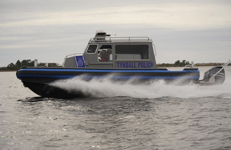 Defenders from the 325th Security Forces Squadron patrol the coastline around Tyndall Air Force Base, Fla., Jan. 26, 2016, in a valor class North River boat. The new boats will help the 325th SFS provide force protection to 128 miles of shoreline in support of 325th Fighter Wing and 30 associate units. (U.S. Air Force photo/Senior Airman Solomon Cook)