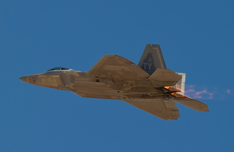 An F-22 Raptor from Tyndall Air Force Base, Fla., flies over Nellis AFB, Nev., during Red Flag 16-1, Feb. 5, 2016. Twelve Tyndall F-22s participated in Red Flag 16-1, a joint-training, full-spectrum readiness exercise designed to provide the most realistic combat training possible. (U.S. Air Force photo/Senior Airman Alex Fox Echols III)