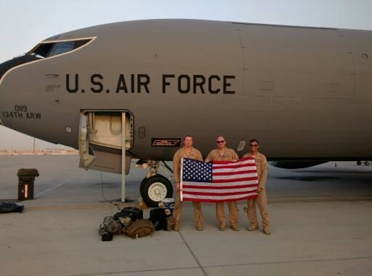 Senior Airman Jonathan Nigl, left, a 384th Air Refueling Squadron boom operator, Maj. Robert Bradley and Capt. Nathanial Beer, both 384th ARS pilots, pose for a photo in front of their aircraft. (Courtesy photo)