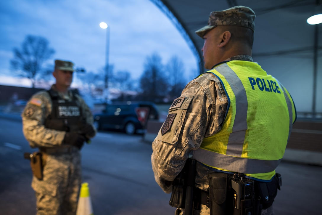 Sgt. Michael Villena (right), U.S. Army Reserve military police Soldier from Manassas Park, Va., with the 352nd MP Company, of the 200th MP Command, talks with Staff Sgt. Micheal Deitz, patrol supervisor for the 289th MP Co., belonging to the 3rd U.S. Infantry Regiment (The Old Guard), during a partnership program giving Army Reserve Soldiers the opportunity to provide law and order, security and patrol support at various active duty installations in the Military District of Washington, D.C., Feb. 17. This partnership pilot program began in early February, placing Army Reserve Soldiers on active duty orders for three weeks while working at Joint Base Myer-Henderson Hall, Fort Lesley J. McNair and the Arlington National Cemetery. Soldiers will also support the Military District of Washington with additional duty days throughout the year. (U.S. Army photo by Master Sgt. Michel Sauret)