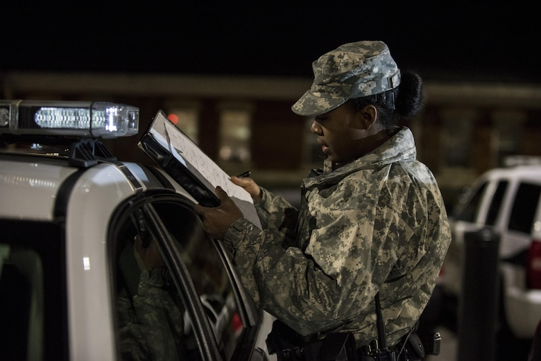 Pvt. Kaloni Alston, U.S. Army Reserve military police Soldier from Temple Hills, Md., with the 443rd MP Company, of the 200th MP Command, conducts a vehicle inspection on her assigned police car during a morning patrol with active duty Soldiers from the 289th MP Co., belonging to the 3rd U.S. Infantry Regiment (The Old Guard), in the Military District of Washington, D.C., Feb. 17. This partnership pilot program began in early February, placing Army Reserve Soldiers on active duty orders for three weeks while working at Joint Base Myer-Henderson Hall, Fort Lesley J. McNair and the Arlington National Cemetery. Soldiers will also support the Military District of Washington with additional duty days throughout the year. (U.S. Army photo by Master Sgt. Michel Sauret)