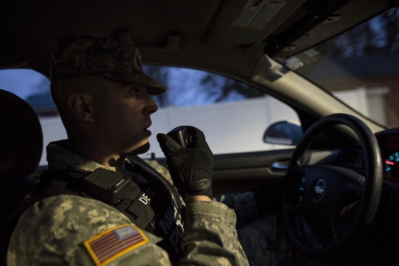 Staff Sgt. Micheal Deitz, patrol supervisor for the 289th Military Police Company, belonging to the 3rd U.S. Infantry Regiment (The Old Guard), calls in his location over the radio while on patrol in the Military District of Washington, D.C., Feb. 17. The 289th MP Co. is currently operating a partnership with U.S. Army Reserve MP Soldiers from the 200th MP Command as part of a pilot program that began in early February, placing Army Reserve MPs on active duty orders for three weeks while working at Joint Base Myer-Henderson Hall, Fort Lesley J. McNair and the Arlington National Cemetery. Soldiers will also support the Military District of Washington with additional duty days throughout the year. (U.S. Army photo by Master Sgt. Michel Sauret)