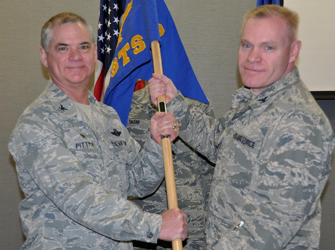 Air Force Reserve Col. Leon Barringer (right) accepts the guidon of the 302nd Aeromedical Staging Squadron from Col. Jay Pittman, Jr., during an assumption of command ceremony at Peterson Air Force Base, Colo., Feb. 7, 2016.  The passing of military organization's guidon signifies the historic, peaceful transfer of leadership from one commander to the next. Barringer took command of the squadron after previously leading the 446th ASTS based at Joint Base Lewis-McChord, Wash. Pittman, commander of the 302nd Airlift Wing, presided over the event. The 302nd ASTS serves the wing by ensuring its members' medical readiness and is responsible for patient staging and critical patient care. (U.S. Air Force photo/2nd Lt. Stephen J. Collier)