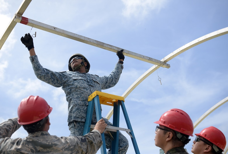 Republic of Singapore Air Force Military Expert 6 Nagenthiran Thurairaj, 508th Engineer Squadron commanding officer, assembles a frame for a small shelter system during Partner Nation Silver Flag, Feb. 13, 2016, at Andersen Air Force, Guam. Silver Flag is a U.S. Pacific Command multilateral Theater Security Cooperation Program subject matter expert exchange event designed to build partnerships and promote interoperability through the equitable exchange of civil engineer related information. This is the first multilateral Partner Nation Silver Flag. (U.S. Air Force photo by Senior Airman Joshua Smoot/Released)