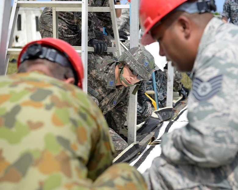 Republic of Korea Air Force Master Sgt. Yong Hwan Han, a barrier maintenance supervisor, secures contour ropes to a base frame for a small shelter system setup during Partner Nation Silver Flag, Feb. 13, 2016, at Andersen Air Force Base, Guam. The exercise is a small part of the first multilateral Silver Flag Exercise, a U.S. Pacific Command multilateral Theater Security Cooperation Program subject matter expert exchange event designed to build partnerships and promote interoperability through the equitable exchange of civil engineer related information. (U.S. Air Force photo by Senior Airman Joshua Smoot/Released)