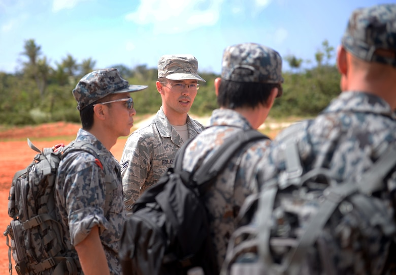 U.S. Air Force Airman 1st Class Daniel Roland, 792nd Intelligence Support Squadron cyber system operator, Joint Base Pearl Harbor-Hickam, Hawaii, translates information from 554th RED HORSE Squadron Silver Flag instructors to Japan Air Self-Defense Force engineers during Partner Nation Silver Flag, Feb. 14, 2016, at Andersen Air Force Base, Guam. Translators were selected throughout the Pacific Air Forces to help with the language barrier presented by the multiple nations involved in the PNSF. (U.S. Air Force photo by Senior Airman Joshua Smoot/Released)