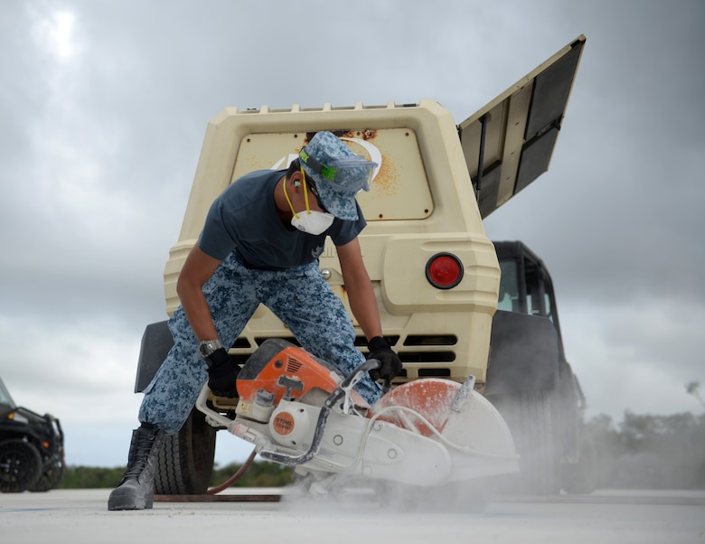 Republic of Singapore Air Force Military Expert 2 Wei Han Tan, crater repair instructor, uses a pavement saw while repairing chips in an airfield during Partner Nation Silver Flag, Feb. 14, 2016, at Andersen Air Force Base, Guam. The exercise is a small part of the first multilateral Silver Flag Exercise, a U.S. Pacific Command multilateral Theater Security Cooperation Program subject matter expert exchange event designed to build partnerships and promote interoperability through the equitable exchange of civil engineer related information. (U.S. Air Force photo by Senior Airman Joshua Smoot/Released)