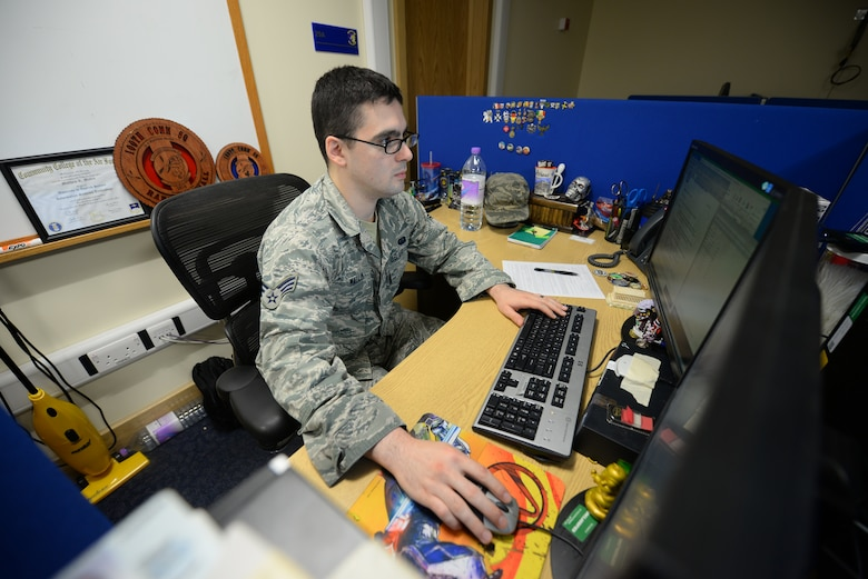U.S. Air Force Senior Airman Matthew Mallin, 100th Communication Squadron wing cyber security technician, works on his computer Feb. 11, 2016 on RAF Mildenhall, England. Mallin and his wife Sasha Southee-Mallin, 48th Medical Support Squadron laboratory technician, provided lifesaving medical care until emergency responders arrived to a heart-attack victim Jan. 17, 2016, while on vacation in Norway. (U.S. Air Force photo by Staff Sgt. Micaiah Anthony/Released)