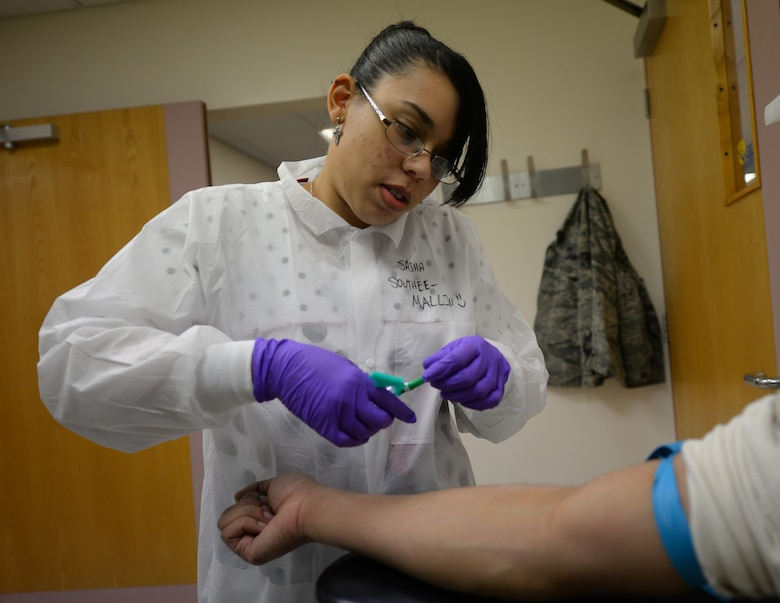 Sasha Southee-Mallin, left, 48th Medical Support Squadron laboratory technician, prepares to draw blood from a patient Feb. 11, 2016 on RAF Lakenheath, England. Southee-Mallin and her husband, U.S. Air Force Senior Airman Matthew Mallin, 100th Communication Squadron wing cyber security technician, provided lifesaving medical care until emergency responders arrived to a heart-attack victim Jan. 17, 2016, while on vacation in Norway. (U.S. Air Force photo by Staff Sgt. Micaiah Anthony/Released)