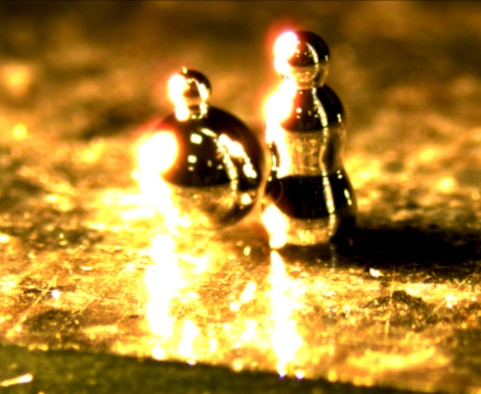 "The enabling attributes of Gallium Liquid Metal Alloys (GaLMAs) make them ideal for 3D freestanding liquid metal structures, as demonstrated by these GaLMA ""snowmen."" These structures can lead to the development of three-dimensional circuitry. (U.S. Air Force photo)"