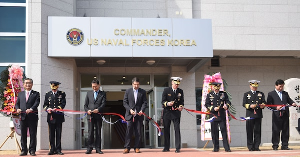 Rear. Adm. Bill Byrne, commander U.S. Naval Forces Korea, Gen. Curtis Scaparrotti,  commander, U.S. Forces Korea, Vice Adm. Ki-sik Lee, commander Republic of Korea Fleet, Maj. Gen. James Walton, director of transformation and re-stationing for U.S. Forces Korea, Hon. Mark Lippert, U.S. ambassador to the Republic of Korea, Jung Gyung-jin, mayor of Busan for administrative affairs, and Lee Jong-cheol, Nam-gu district mayor, cut the ribbon of CNFK's new head quarters building during a ribbon-cutting ceremony. This ceremony marks the opening of CNFK's new headquarters building in Busan since their relocation from Seoul as part of the greater Yongsan Relocation Plan.