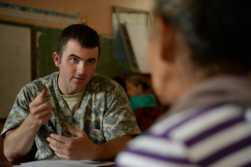 U.S. Army 1st. Lt. Clinton Stephens, Joint Task Force-Bravo Medical Element nurse, screens a local woman during a Medical Readiness Training Exercise in the Cortes Department, Honduras, Feb. 18, 2016. The screening process is a very crucial step in diagnosing patients to help them with further treatment and prescription medication.  (U.S. Air Force Photo by Staff Sgt. Westin Warburton/Released)