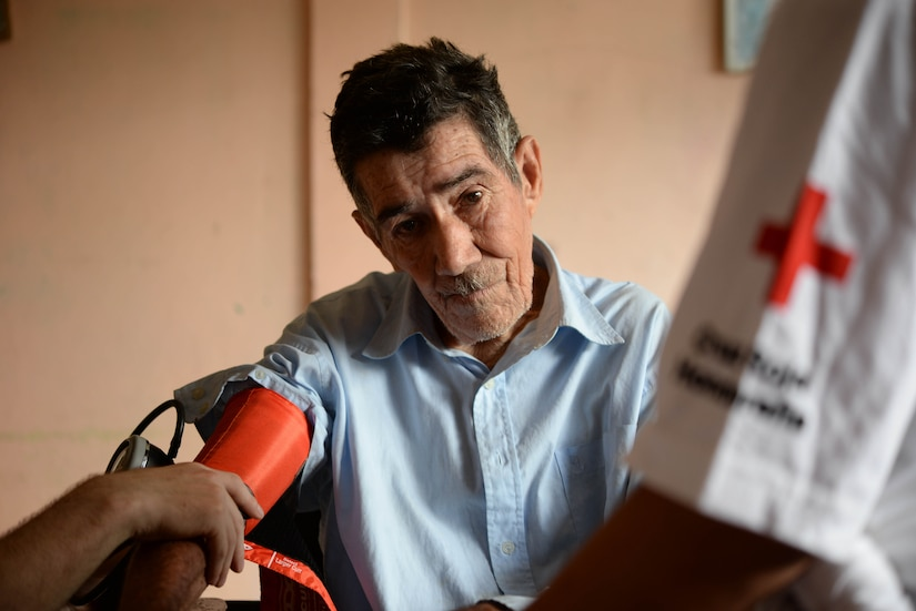 A local man gets his blood pressure checked during a Medical Readiness Training Exercise in the Cortes Department, Honduras, Feb. 18, 2016. These exercises provide military members with essential training and allow the members of Joint Task Force-Bravo Medical Element to practice real world skills in austere locations while developing relationships with host nation partners.  (U.S. Air Force Photo by Staff Sgt. Westin Warburton/Released)