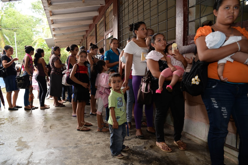 Hondurans wait to see screening nurses during a medical readiness training exercise in the Cortes Department, Honduras, Feb. 18, 2016. During the screening phase, patients are checked by U.S. Army nurses to determine what treatment or medication is needed.  (U.S. Air Force Photo by Staff Sgt. Westin Warburton/Released)