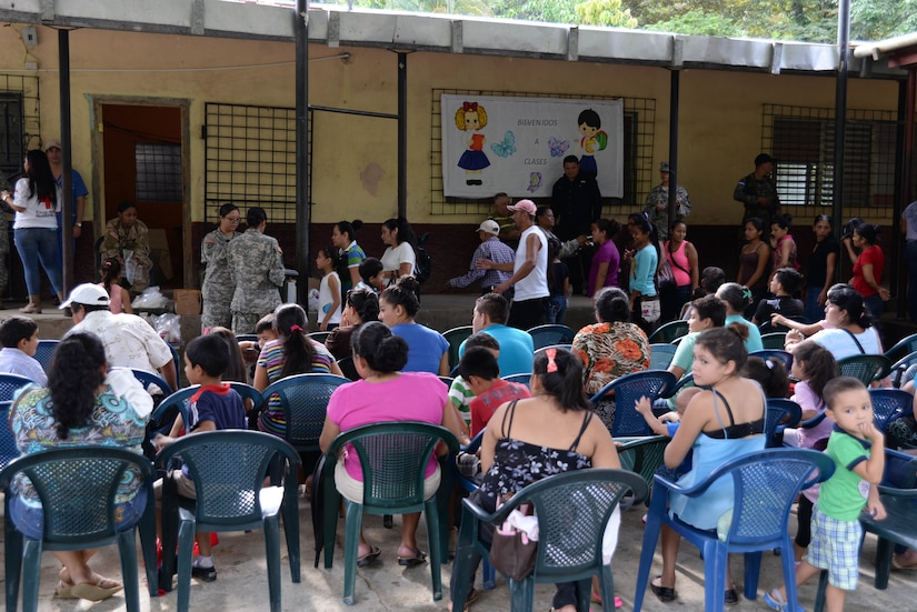 Hondurans listen to a preventative medicine briefing during a medical readiness training exercise in the Cortes Department, Honduras, Feb. 18, 2016. MEDRETES like this provide locals with basic medical treatments along with prescription medicine and dental services and build relashionships between locals and U.S. military forces within the host country.  (U.S. Air Force Photo by Staff Sgt. Westin Warburton/Released)