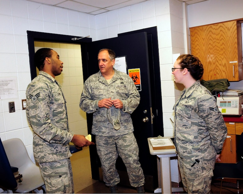 "U.S. Air Force Command Chief Master Sgt. Salvatore ""Sal"" Pecorella, talks with Senior Airman Deris Lewis and Airman 1st Class, Caitlin Sunday, members of the 145th Medical Group during February's Unit Training Assembly at the North Carolina Air National Guard Base, Charlotte Douglas International Airport, Feb. 6, 2016. Pecorella, who was recently selected as the new command chief for the 145th Airlift Wing, stays in touch with his Airmen by keeping the lines of communication open. Pecorella began his military career when he enlisted in the Air Force in May 1983, now he continues his career by carrying out his duties as a traditional guardsman in the highest enlisted position. (U.S. Air National Guard photo by Master Sgt. Patricia F. Moran/Released)"