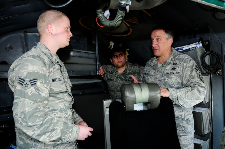 "U.S. Air Force Command Chief Master Sgt. Salvatore ""Sal"" Pecorella, talks with Senior Airman Taylor Wheless and Tech. Sgt. Andrew Casasanta, crew chiefs for the 145th Aircraft Maintenance Squadron on the flight deck of a C-130 Hercules aircraft, during February's Unit Training Assembly at the North Carolina Air National Guard Base, Charlotte Douglas International Airport, Feb. 6, 2016. Pecorella, who was recently selected as the new command chief for the 145th Airlift Wing, stays in touch by keeping the lines of communication open. Pecorella began his military career when he enlisted in the Air Force in May 1983, now he continues his career by carrying out his duties as a traditional guardsman in the highest enlisted position. (U.S. Air National Guard photo by Master Sgt. Patricia F. Moran/Released)"