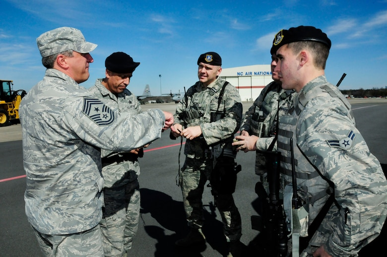 "U.S. Air Force Command Chief Master Sgt. Salvatore ""Sal"" Pecorella, talks with members of the 145th Security Forces Squadron during February's Unit Training Assembly at the North Carolina Air National Guard Base, Charlotte Douglas International Airport, Feb. 6, 2016. Pecorella, who was recently selected as the new command chief for the 145th Airlift Wing, stays in touch by keeping the lines of communication open. Pecorella began his military career when he enlisted in the Air Force in May 1983, now he continues his career by carrying out his duties as a traditional guardsman in the highest enlisted position. (U.S. Air National Guard photo by Master Sgt. Patricia F. Moran/Released)"