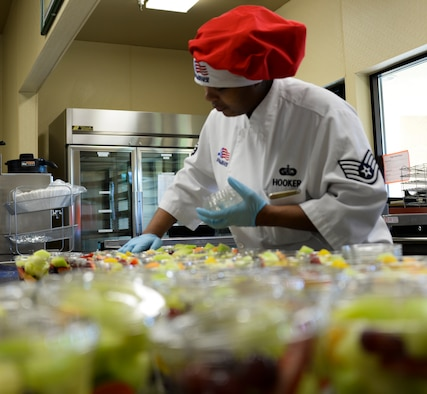 Staff Sgt. Jamie Hooker, 60th Force Support Squadron food service specialist, prepares fruit cups Feb. 16 at Travis Air Force Base, California. An important part of food services job is food preparation and dissemination to the eight food service locations on base. (U.S. Air Force photo by Airman 1st Class Amber Carter)