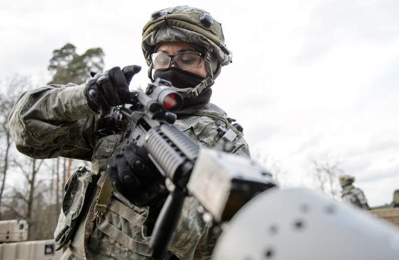 Staff Sgt. Yvonne Solorio, 1st Combat Communications Squadron client system technician, clears her weapon after a mock fire fight Feb. 12, 2016, at Ramstein Air Base, Germany. The Airmen worked in shifts to guard and provide a quick response force to ensure the operations at their training base continued uninterrupted. (U.S. Air Force photo/Staff Sgt. Armando A. Schwier-Morales)