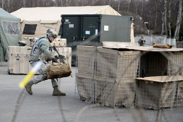 Senior Airman Zachery Davis, 1st Combat Communications Squadron electrical power production technician, positions himself to counter a mock opposition forces attack on Ramstein Air Base, Germany Feb. 12, 2016. The 1st CBCS trains Airmen in a variety of scenarios as they may deploy to any part of the European and African theaters. (U.S. Air Force photo/Staff Sgt. Armando A. Schwier-Morales)