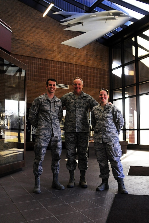 Air Force Chief of Staff Gen. Mark A. Welsh III, center, Senior Airman Joel Pfiester, a 509th Bomb Wing Public Affairs photojournalist, left, and Senior Airman Emili Koonce, a 509th BW Public Affairs broadcast journalist, stand for a photo at the 509th BW headquarters building at Whiteman Air Force Base, Mo., Feb. 17, 2016. Welsh had the opportunity to meet with Airmen from various units on base and held an all call where he discussed Air Force issues and showed his support for the unique Total Force Integration mission at Whiteman. (U.S. Air Force photo by Senior Airman Joel Pfiester)