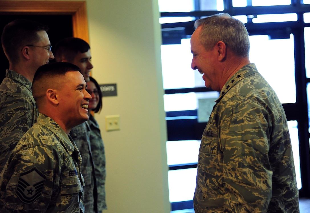 U.S. Air Force Master Sgt. Christopher Espinosa, a medical logistics flight chief from the 509th Medical Operations Squadron, shares a laugh with Air Force Chief of Staff Gen. Mark A. Welsh III at Whiteman Air Force, Mo., Feb. 16, 2016. Welsh met with Airmen and civic leaders during a base tour and held an all call where he expressed his gratitude to the Total Force Airmen and their support of the unique B-2 mission at Whiteman. (U.S. Air Force photo by Senior Airman Joel Pfiester)