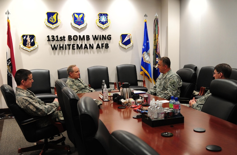 Air Force Chief of Staff Gen. Mark A. Welsh III, left center, speaks to Maj. Gen. Steve Danner, adjutant general of the Missouri National Guard, right center, during a visit at Whiteman Air Force Base, Mo., Feb. 17, 2016. Welsh met with Danner and base leadership to speak about the evolution of Total Force Integration and modernizing for the future. (U.S. Air Force photo by Senior Airman Joel Pfiester)